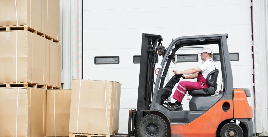 12874549 - worker driver at warehouse forklift loader works
