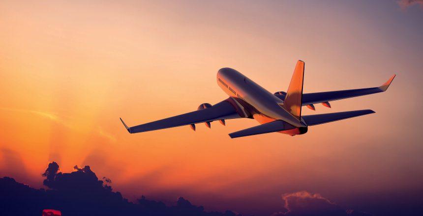 a17014902-airplane-flight-sunset